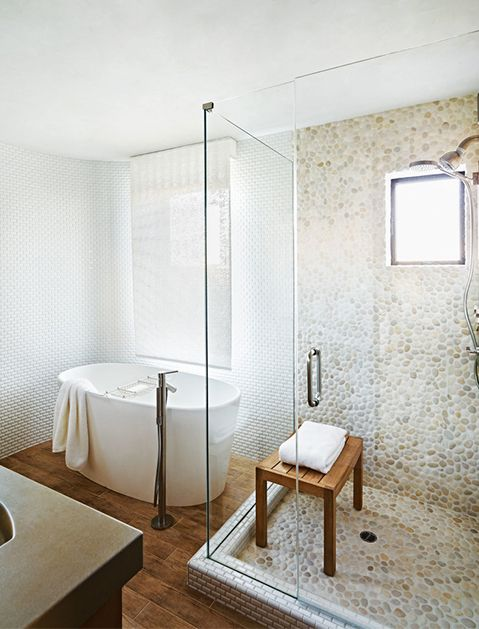 """a freestanding """"greek"""" style soaking bath will fit easily in any current corner tub space"""