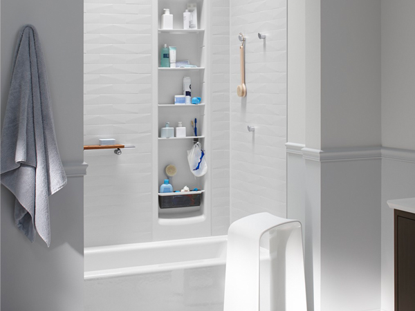the kohler choreograph system consists of large groutless wall panels with customizable accessories
