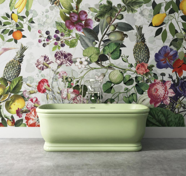 devon & devon cast iron mint green traditional cast iron tub with bright floral wallpaper - the ultimate guide to luxury plumbing by the delight of design