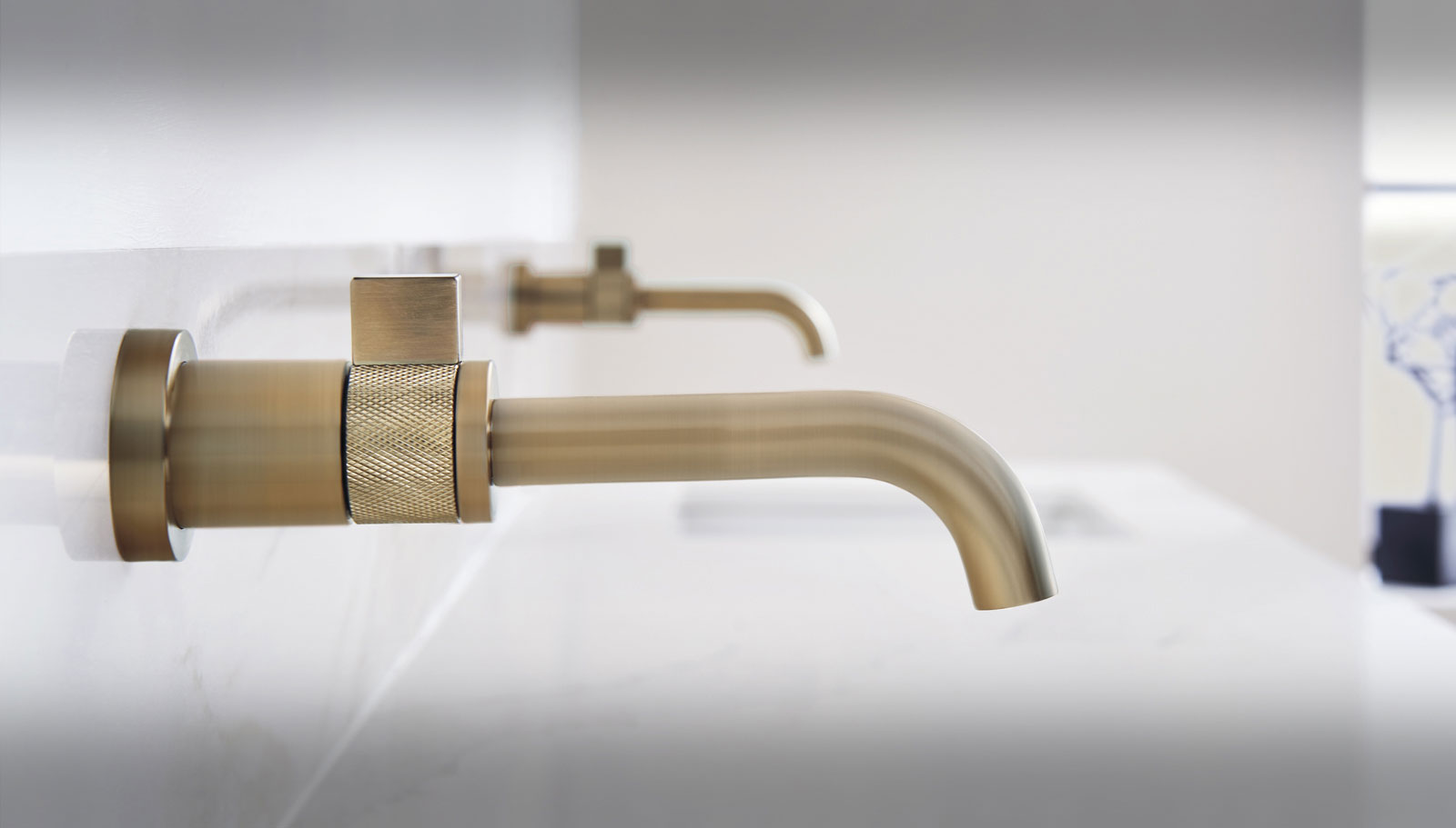 brizo single hole wall mounted lav faucet in luxe gold - the ultimate guide to luxury plumbing by the delight of design