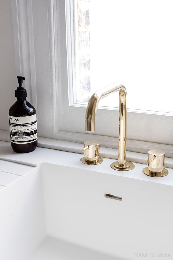 vola contemporary minimalist widespread kitchen faucet with lever knobs in polished gold with 90 degree spout - the ultimate guide to luxury plumbing by the delight of design
