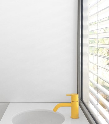 vola contemporary minimalist single hole lav faucet with top lever control and low spout in bright yellow - the ultimate guide to luxury plumbing by the delight of design