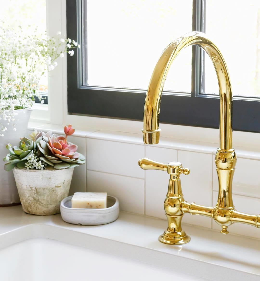 newport brass traditional two hole bride kitchen faucet with lever handles and gooseneck spout in polished gold - the ultimate guide to luxury plumbing by the delight of design