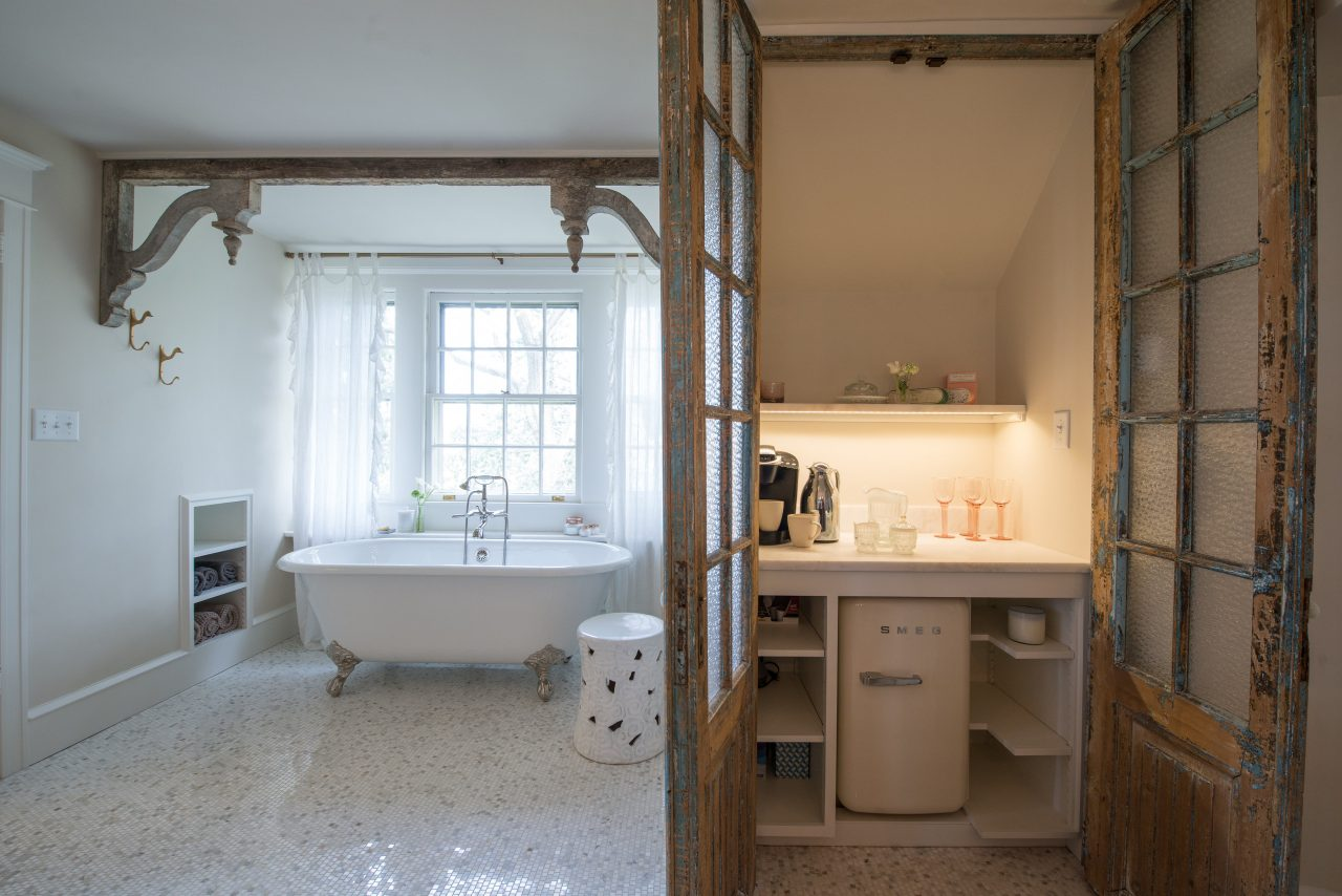 rustic traditional coffee bar in master bathroom with french doors smeg fridge clawfoot tub