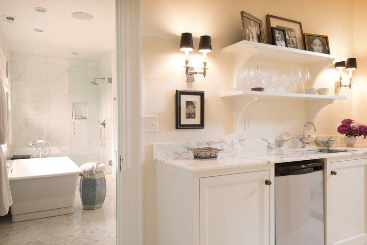 clean and contemporary coffee bar off of master suite bathroom