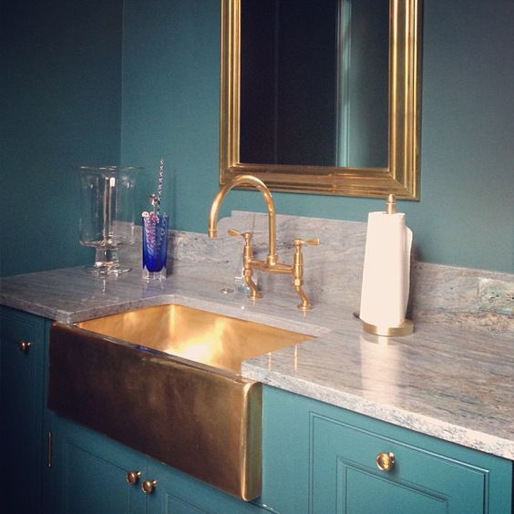 gold apron front farmhouse sink in wetbar