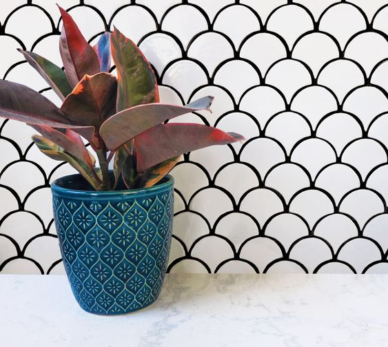 white mermaid scale scallop tiles with black statement grout