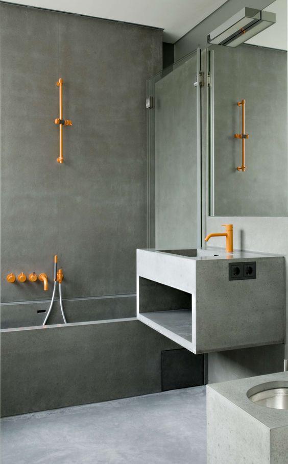 orange colored shower trim and tub filler