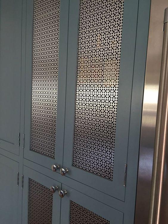 dark grey inset cabinets brass mesh metal panel insert