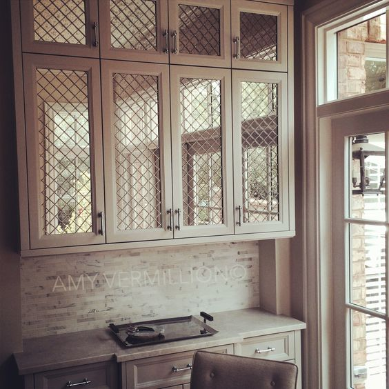 taupe overlap cabinet with antiqued mirror and wire mesh insert