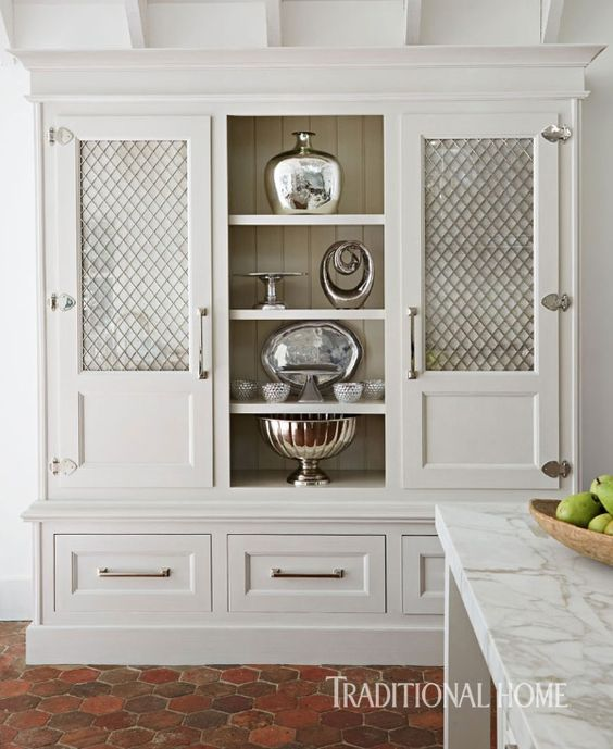 cream cabinets with wire mesh panel insert