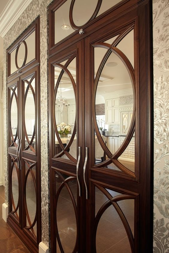 dark wood cabinet with mirror and decorative mullion insert