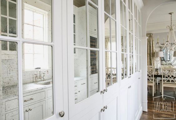 white cabinet with antiqued mirror and mullion insert