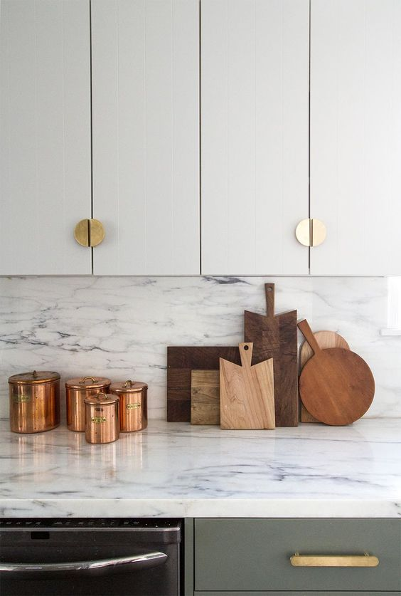 two tone custom ikea kitchen cabinets brass half moon pulls marble backsplash