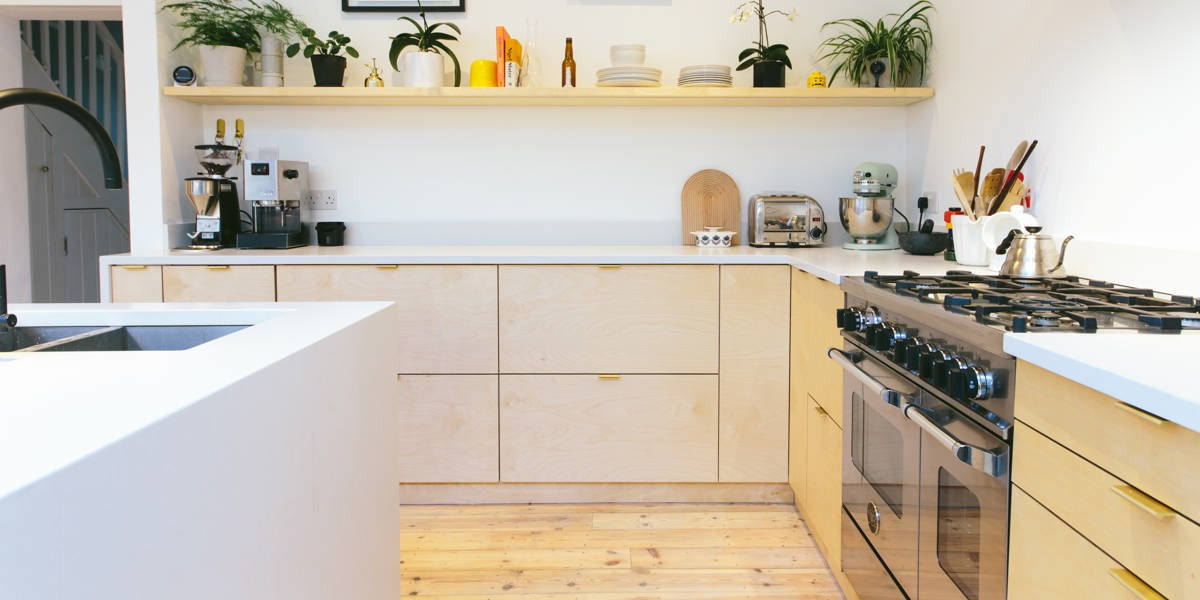 custom unfinished kitchen cabinetry modern slab plywood ikea brass pull open shelving