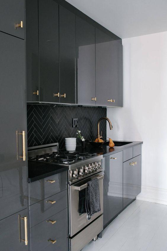 contemporary black custom ikea kitchen cabinetry gloss brass pull