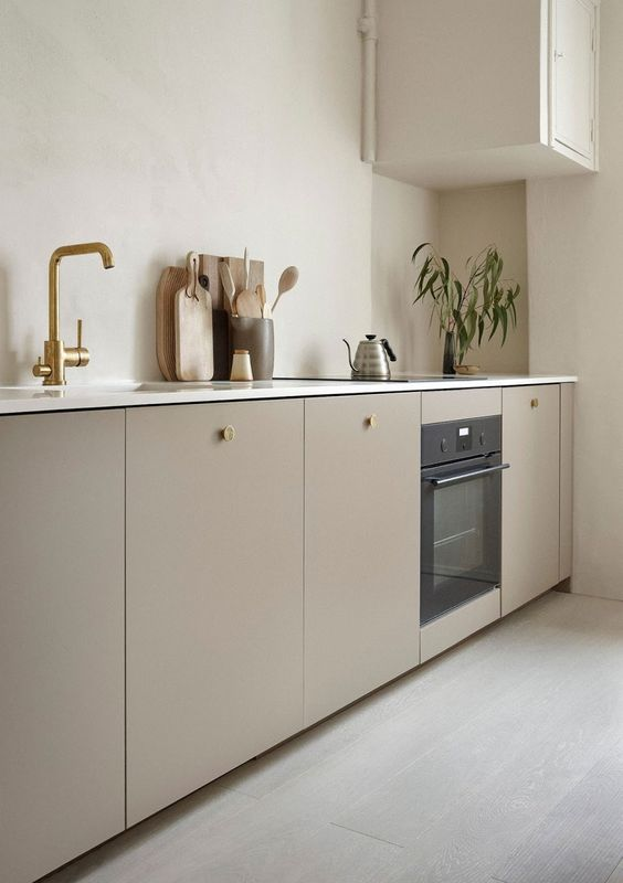 simplistic minimal ikea kitchen cabinetry custom front brass finish