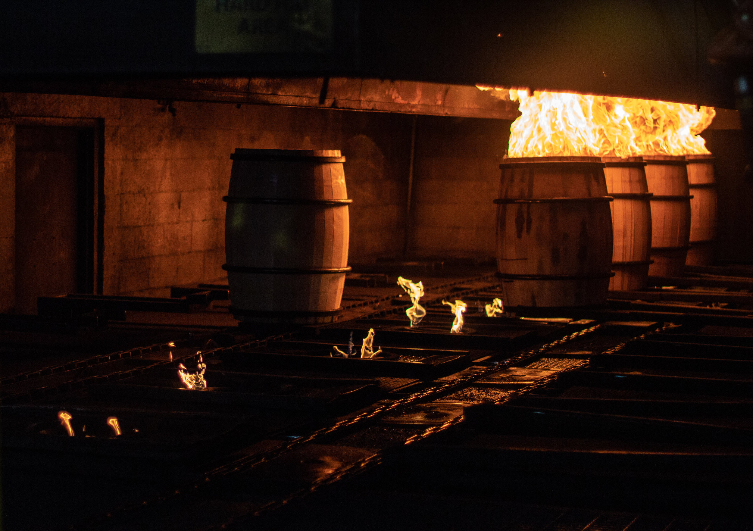 Barrels being charred at the Brown-Forman Cooperage.
