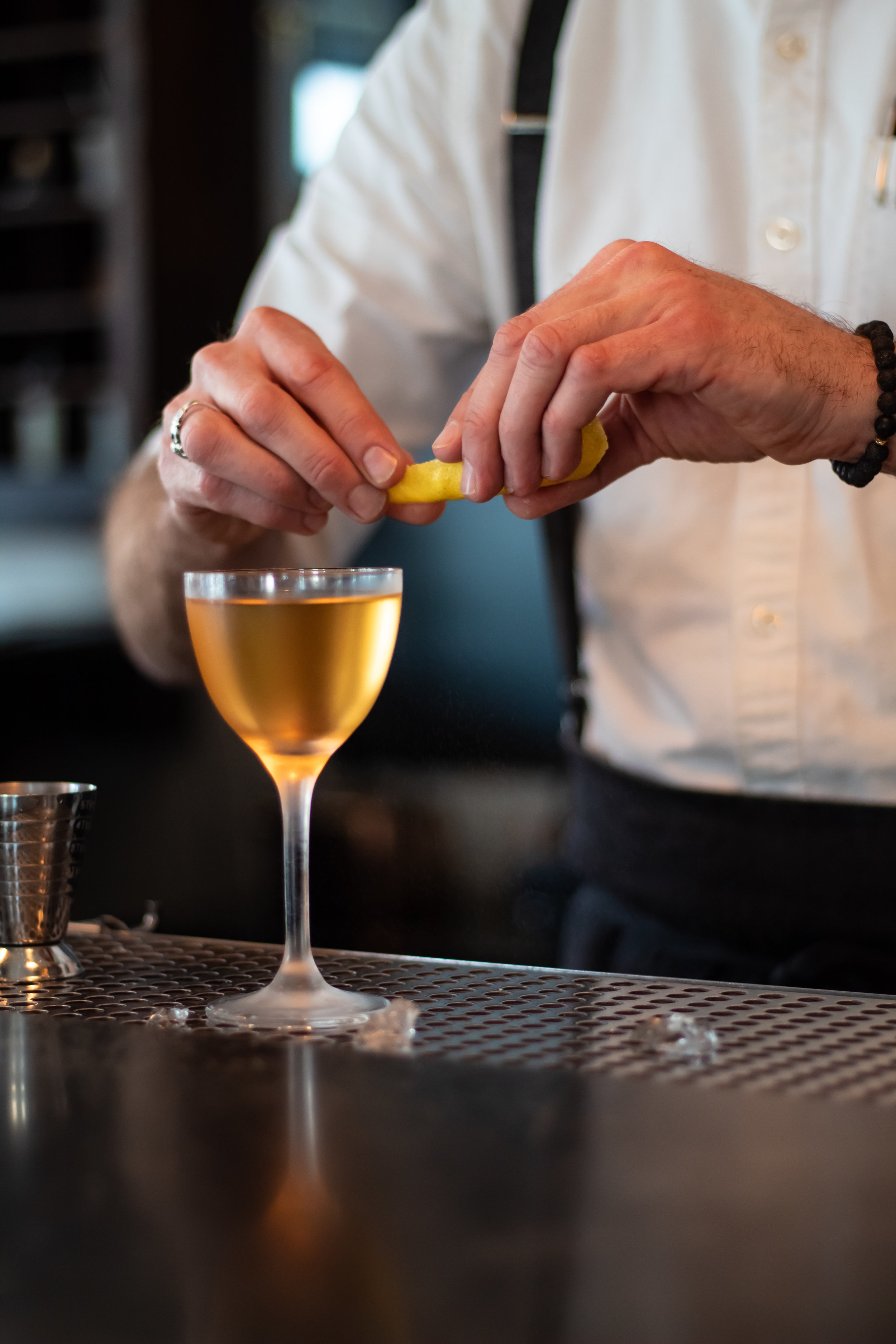 Sean Meagher mixing the Cold Feet, made with  mezcal , white  Armagnac , blanc  vermouth , Licor 43 , and  Angostura  and orange bitters.