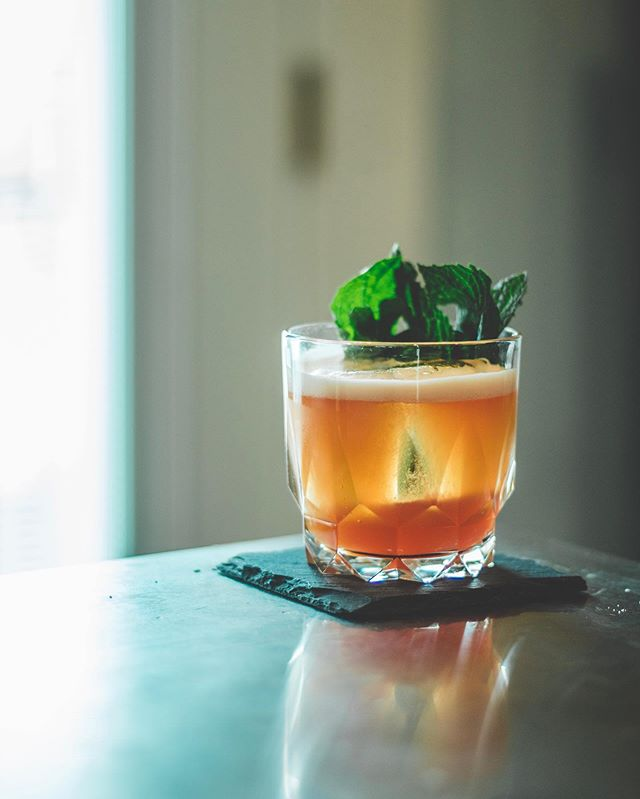 Tropical/tiki/exotic cocktails are probably my favorite of all styles of cocktail; but they are also a bit more involved and complex, so I find that I don't make them as often at home 🍹. . When I do, they are typically something as simple as tiki can get—the Jungle Bird is a perfect example of this. It's made with only 5 ingredients which is as stripped down as it gets for the category, annnnd it's very malleable—meaning you can swap out one ingredient for another very easily. It's also the perfect template for bitter tiki cocktails 😁👌🏽🍹. . Jungle Bird 🐦 🍹 (Origin: Kuala Lampur Hilton 1978). - 1.5 oz Dark rum (I used a split of @plantation.rum dark and OFTD overproof) - .75 oz Campari - .5 oz Lime - .5 oz Demerara syrup - 1.5 oz Pineapple juice (fresh is better if possible) • Method- shake vigorously; strain over large cube and garnish with mint and a pineapple leaf if you have one.