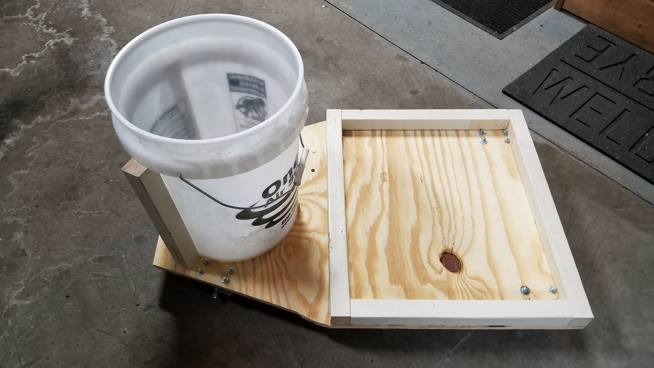 - I bolted the bottom bucket to the plywood.