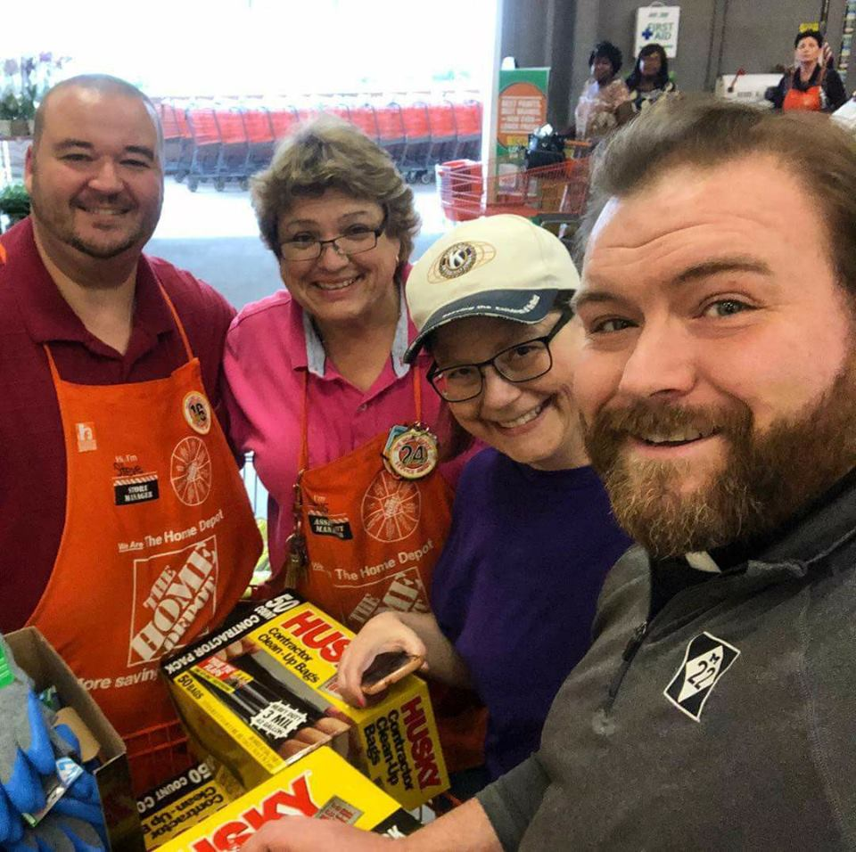 Home Depot Manager Steve (left), another HD employee, Kennette Mitchell and Fr. Jim Perra get the selfie.