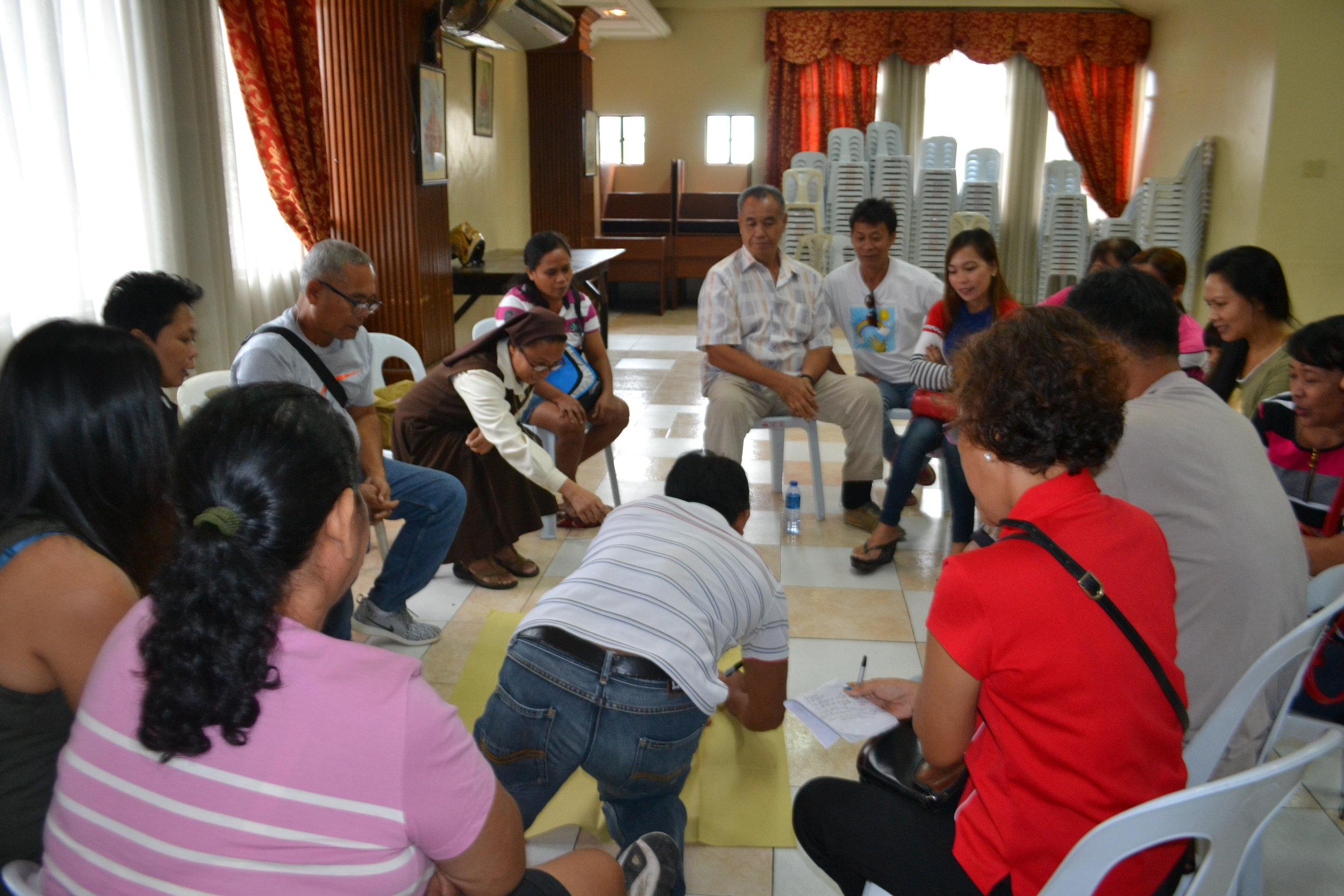 SHEM workshop with reflexologists.JPG