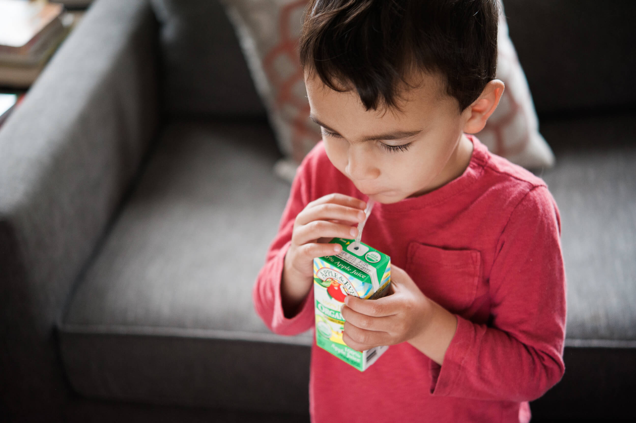 Kid drinking juice box Brooklyn family photographer lifestyle session in Cobble Hill neighborhood apartment by Lindsey Victoria Photography