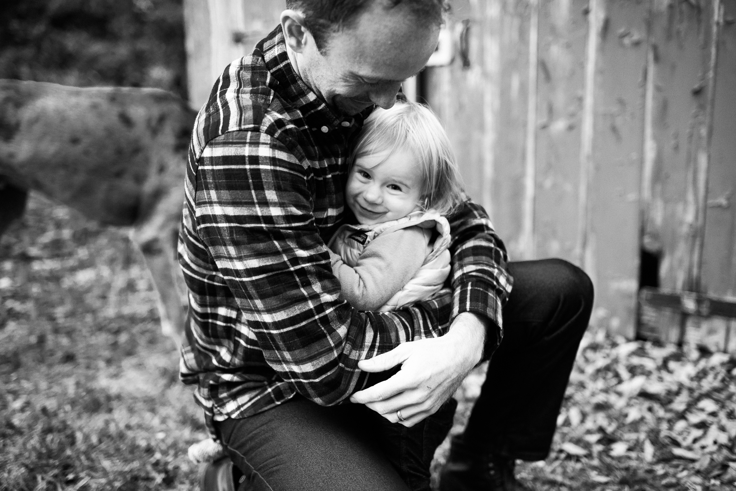 family photo daddy hugging daughter New England barn black and white Washington CT by Lindsey Victoria Photography