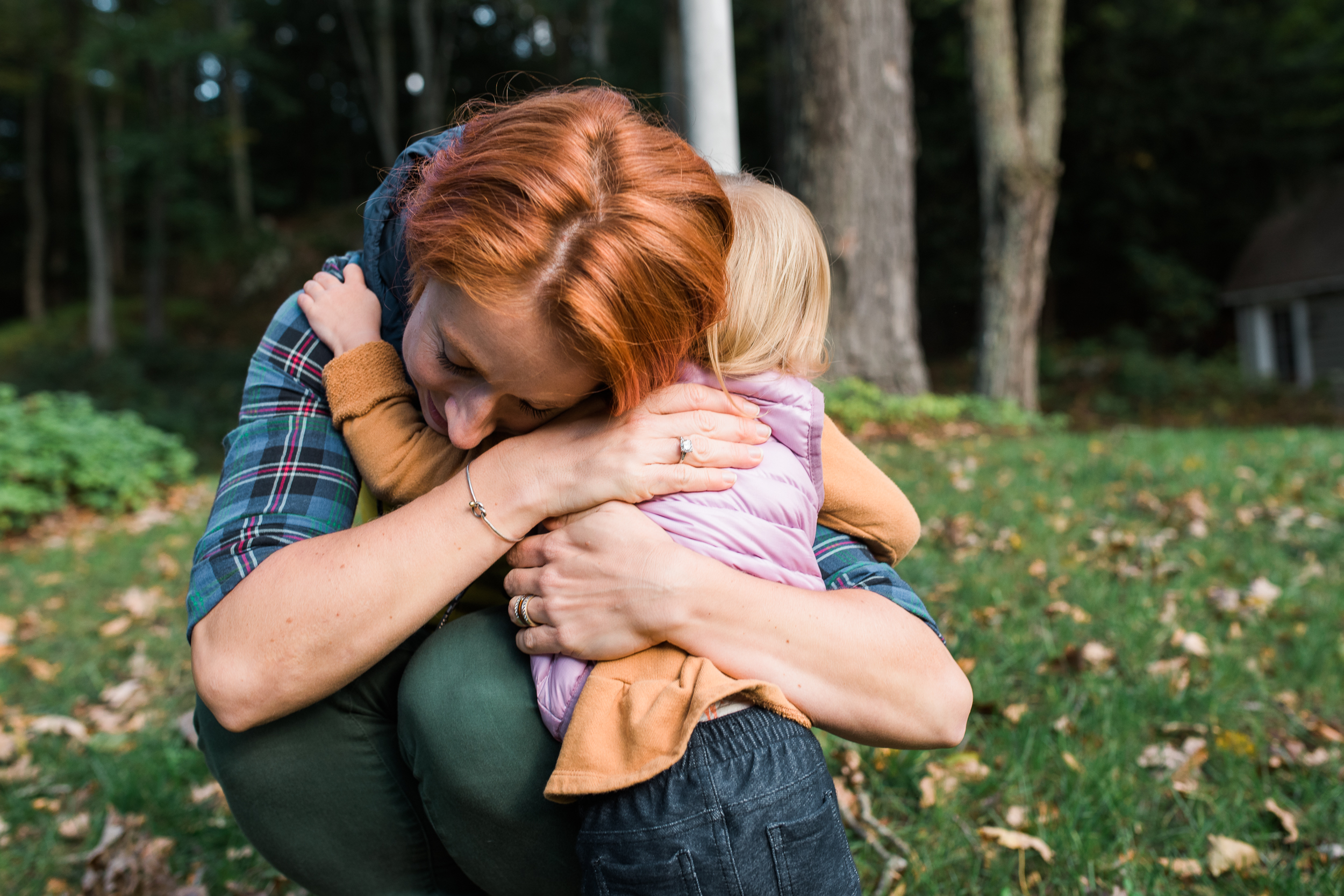 redhead mother hugging daughter family photo session by Lindsey Victoria Photography in Washington Connecticut