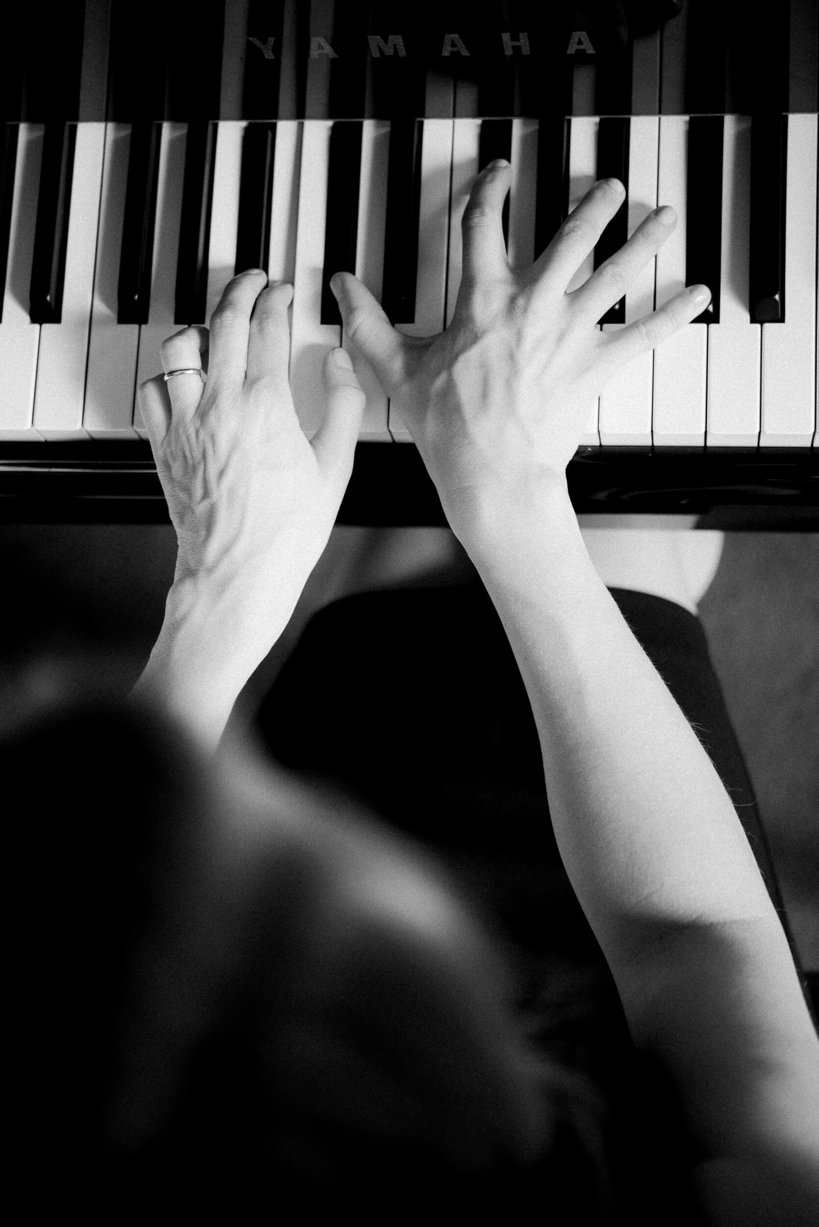 Jen Allen jazz piano Branding Headshot Session black and white image of hands on piano keys in the Choral Room at Taft School in Litchfield County by Lindsey Victoria Photography