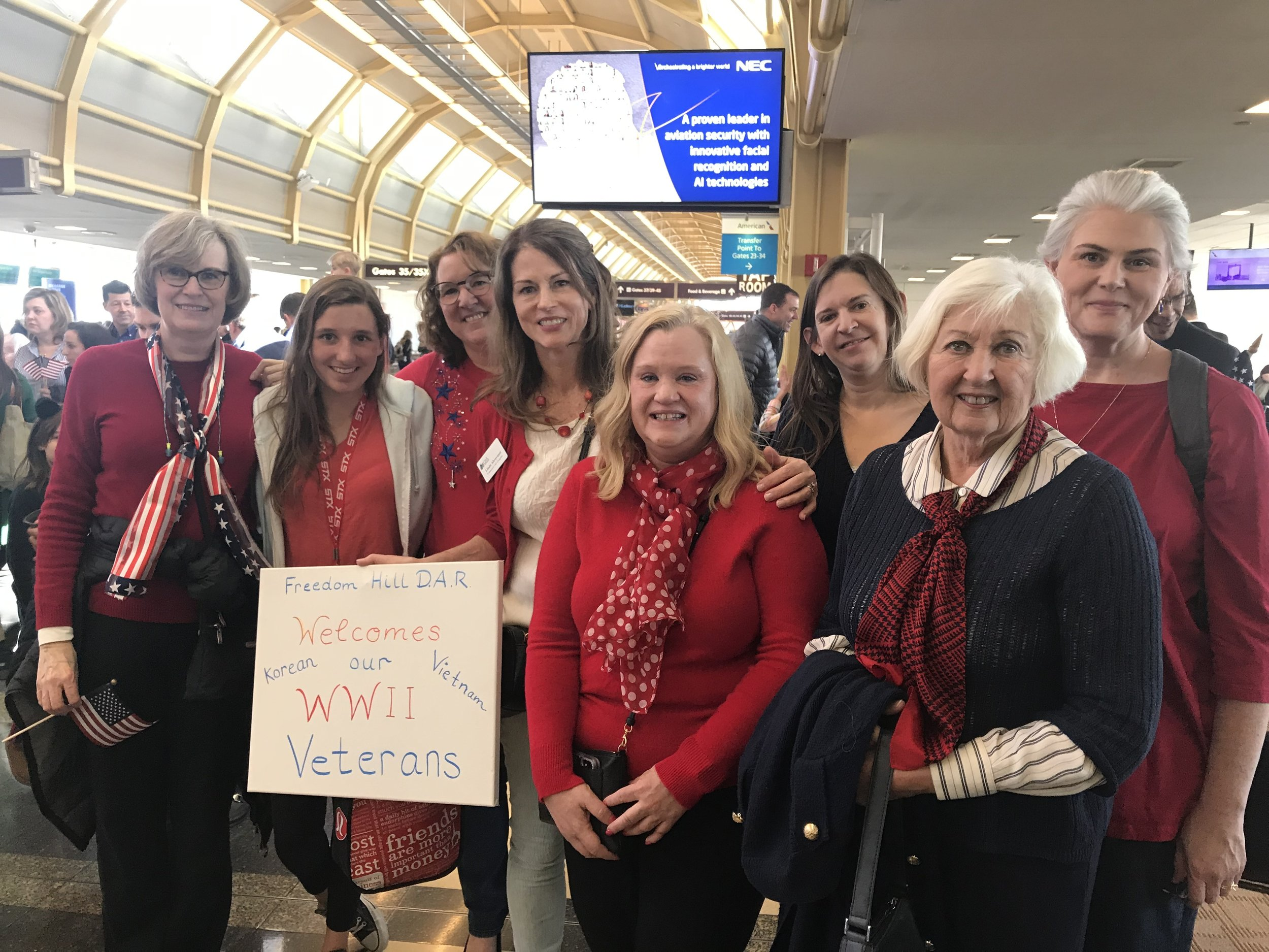 Freedom Hill Daughters greet veterans at their Honor Flight, Reagan National Airport, March 2019