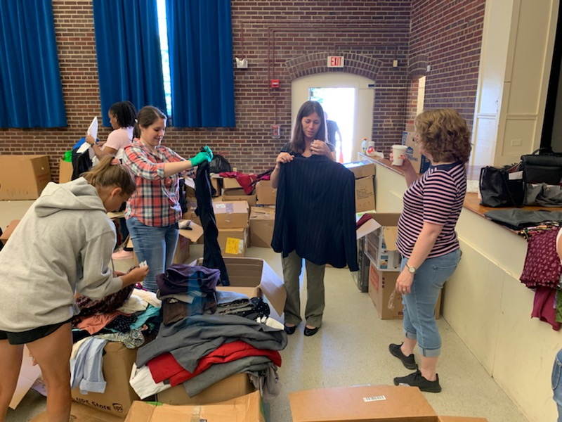 Freedom Hill Daughters sort clothing for Final Salute's Next Uniform event for female veterans transitioning to civilian life. August 2019