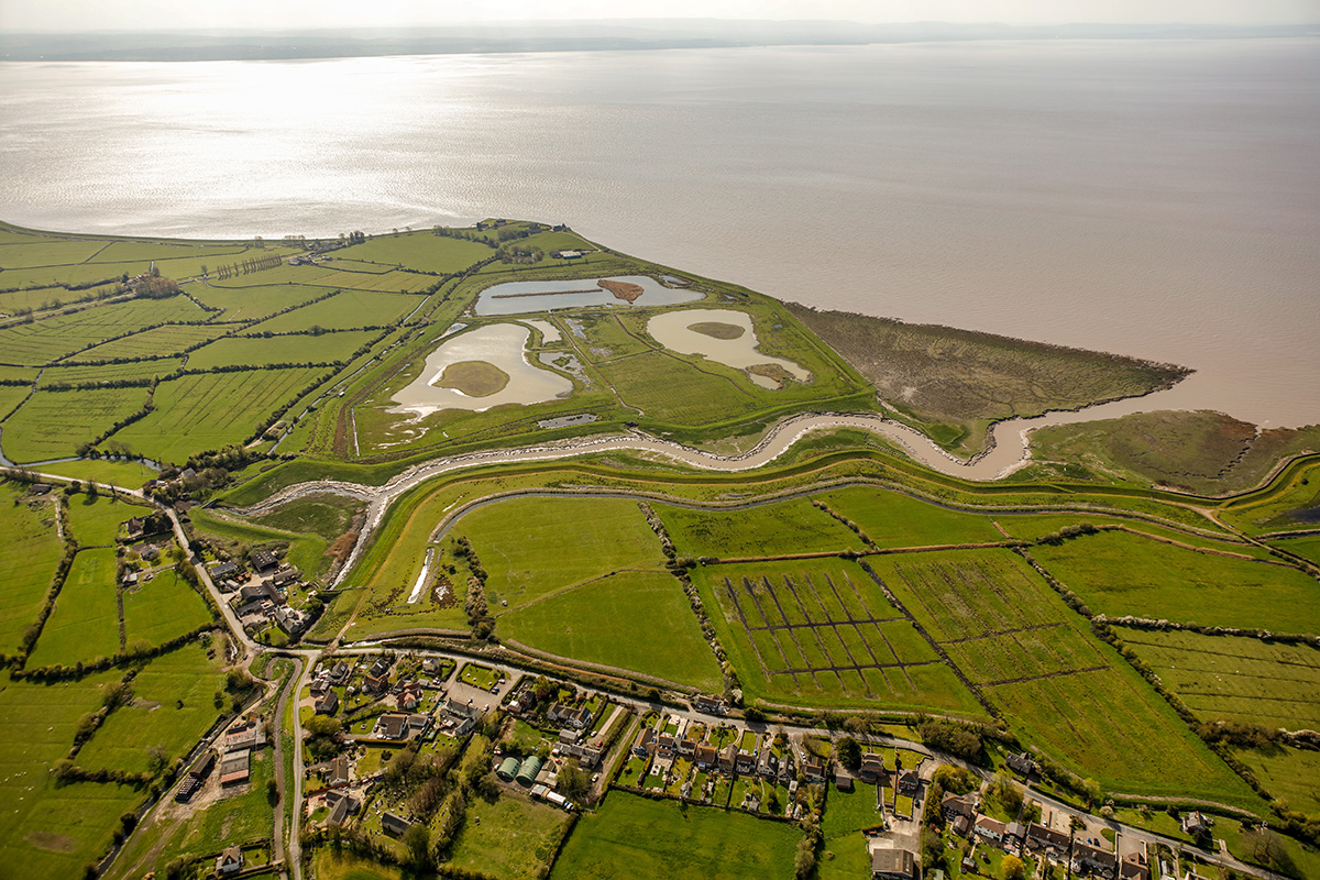 Looking south-east over Goldcliff village, Goldcliff Pill, and the lagoons.