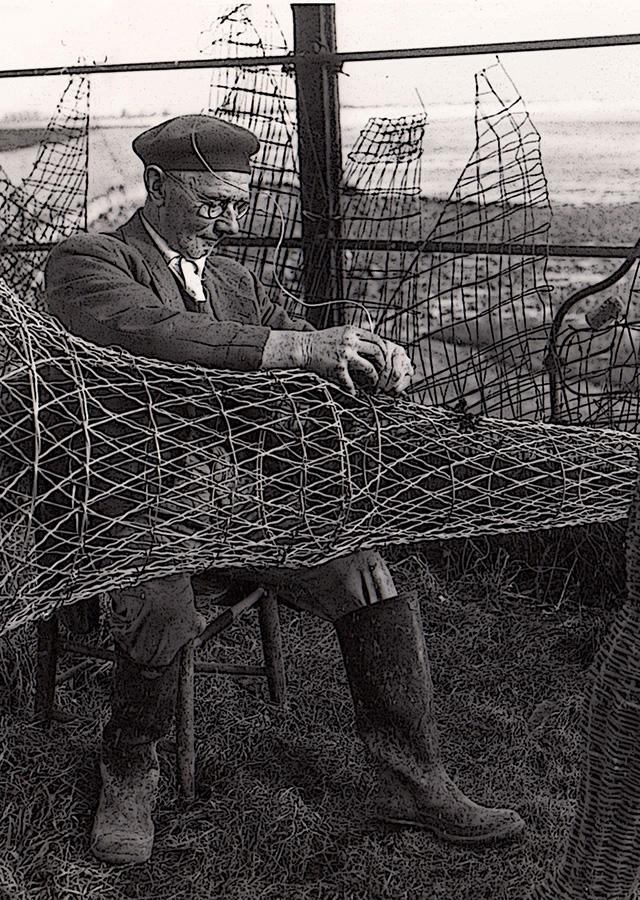 Wyndham Howells repairing putcher nets.