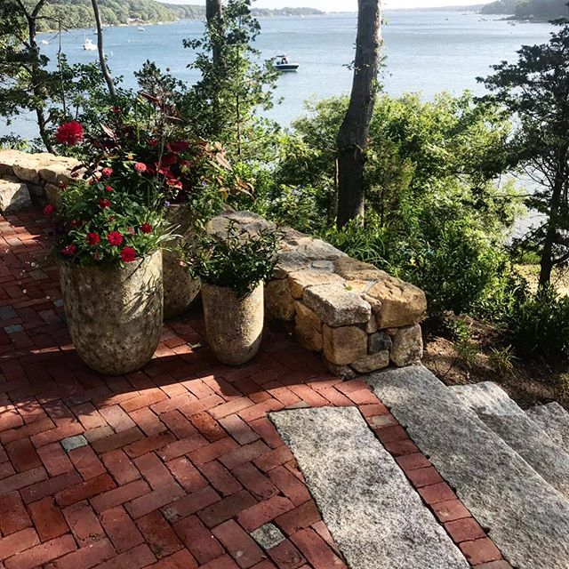 Multiple types of #hardscape materials to create this #herringbone #brick patio with #reclaimed #granite overlooking the pond. #marthasvineyard #vineyardhaven #oakbluffs #edgartown Thank you @worthandwing & @kkurman!