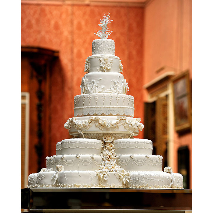 9. The Cake - Did you know that even the royal wedding cake is steeped in tradition? First and foremost, rich, dense fruitcake is the established flavor of choice in the royal family (Harry and Meghan are one of the first couples to skip this with their lemon-elderflower cake). The cakes are usually massive, reaching several feet high with multiple tiers, and may be decorated with intricate piping designs, the couple's emblem or monogram, or exquisite blooms. One funny royal tradition surrounding the cake is mailing out slices to those who could not attend the wedding as well as to thank those who did come. While shipping out cake by post may not be easily feasible, a delightful way to incorporate this idea into your own event is to package up individual pieces of cake in little boxes to send home with your guests as unique, decidedly-royal reception favors.