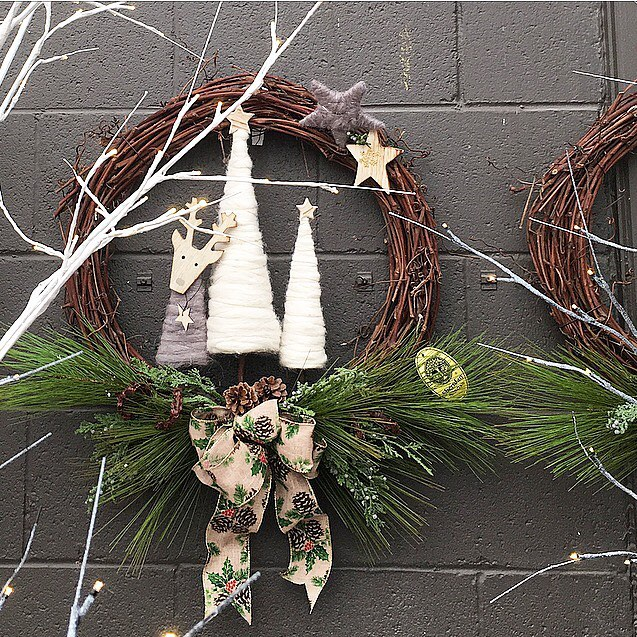 """You don't need to stay """"inside the lines"""" when designing your holiday wreaths! We love @sheridannurseries use of our whimsical deer and tree figures in the centre of their design. #holidaydecor #holidaywreath #homedecor #christmasdecor #moduslifestyle2016"""