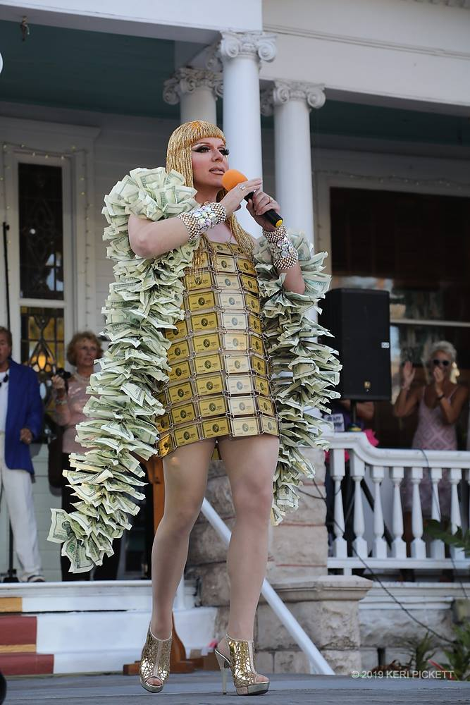 performer on stage wearing dress made of American Express cards