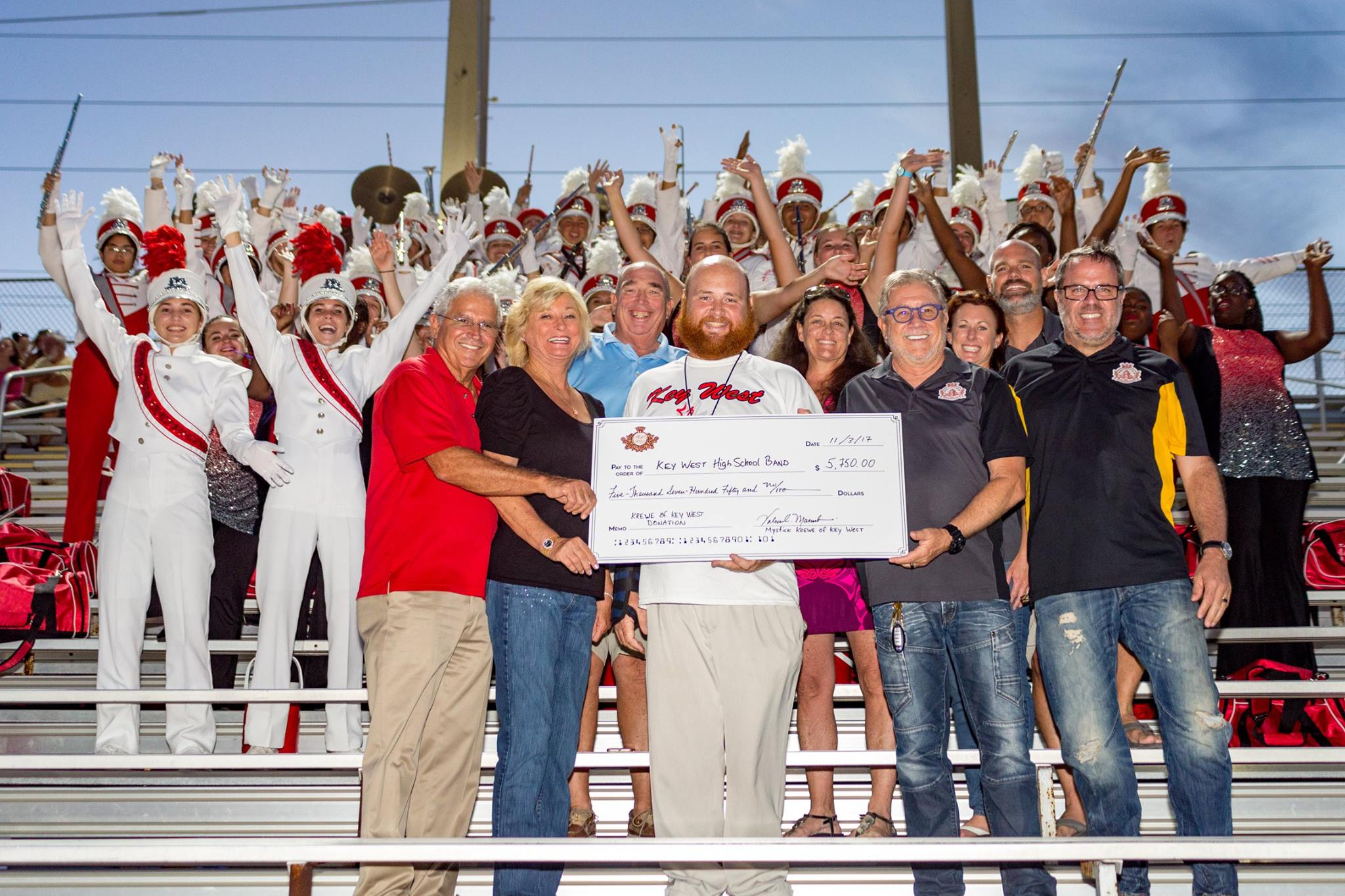 Krewe members present check for $5,750.00 to Key West High School Band