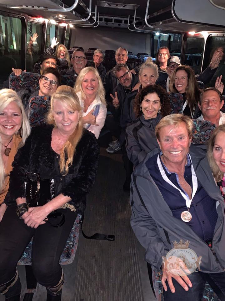 group photo of members on bus