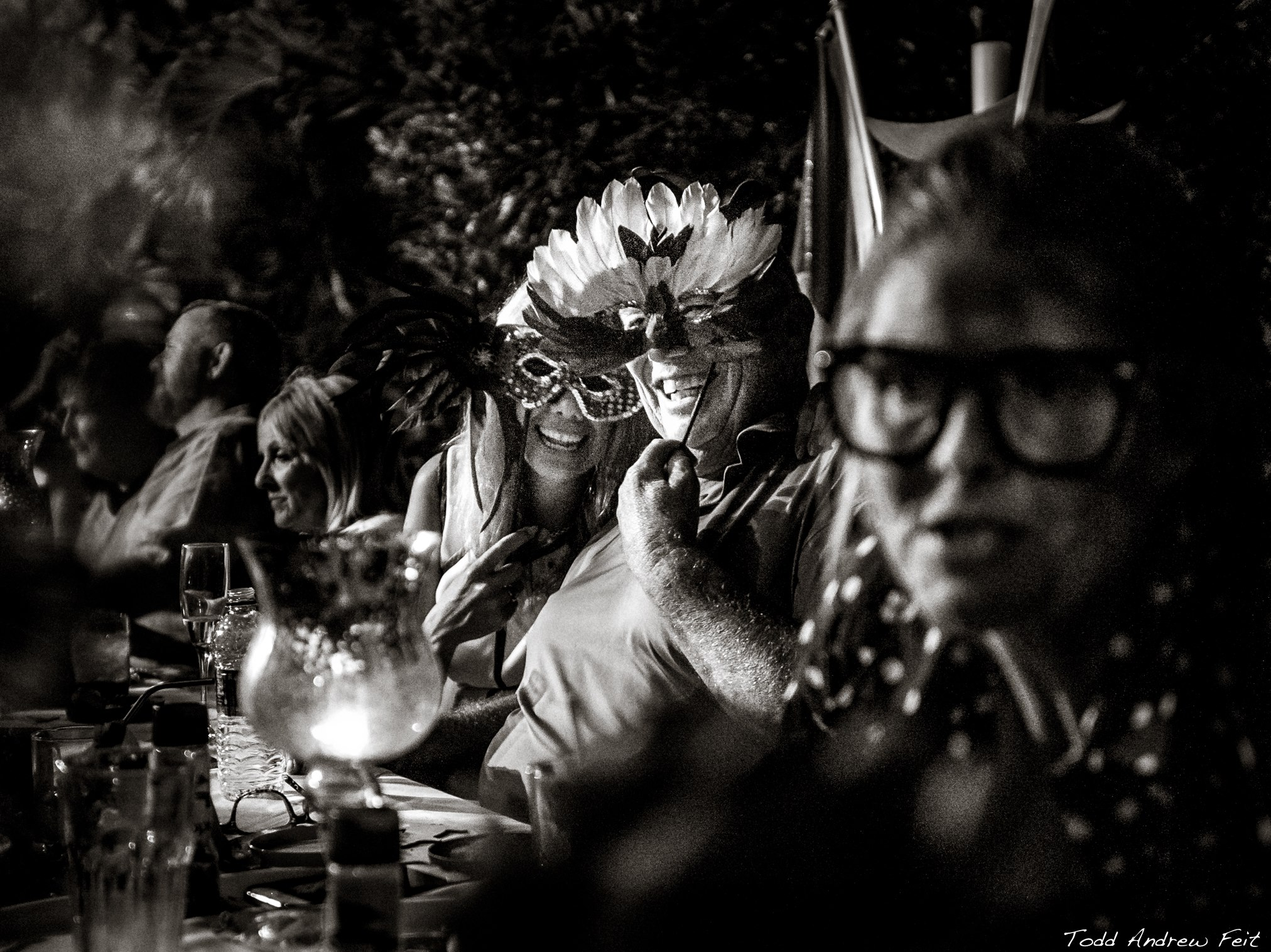 members at dinner table wearing masks