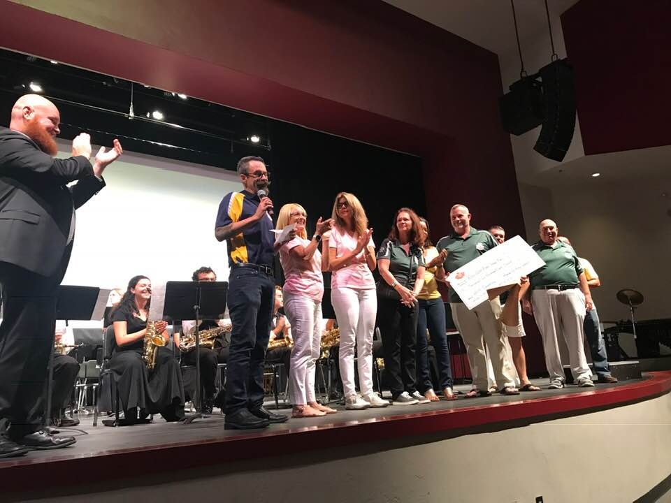 Krewe presents Key West High School Band check for new band uniforms.
