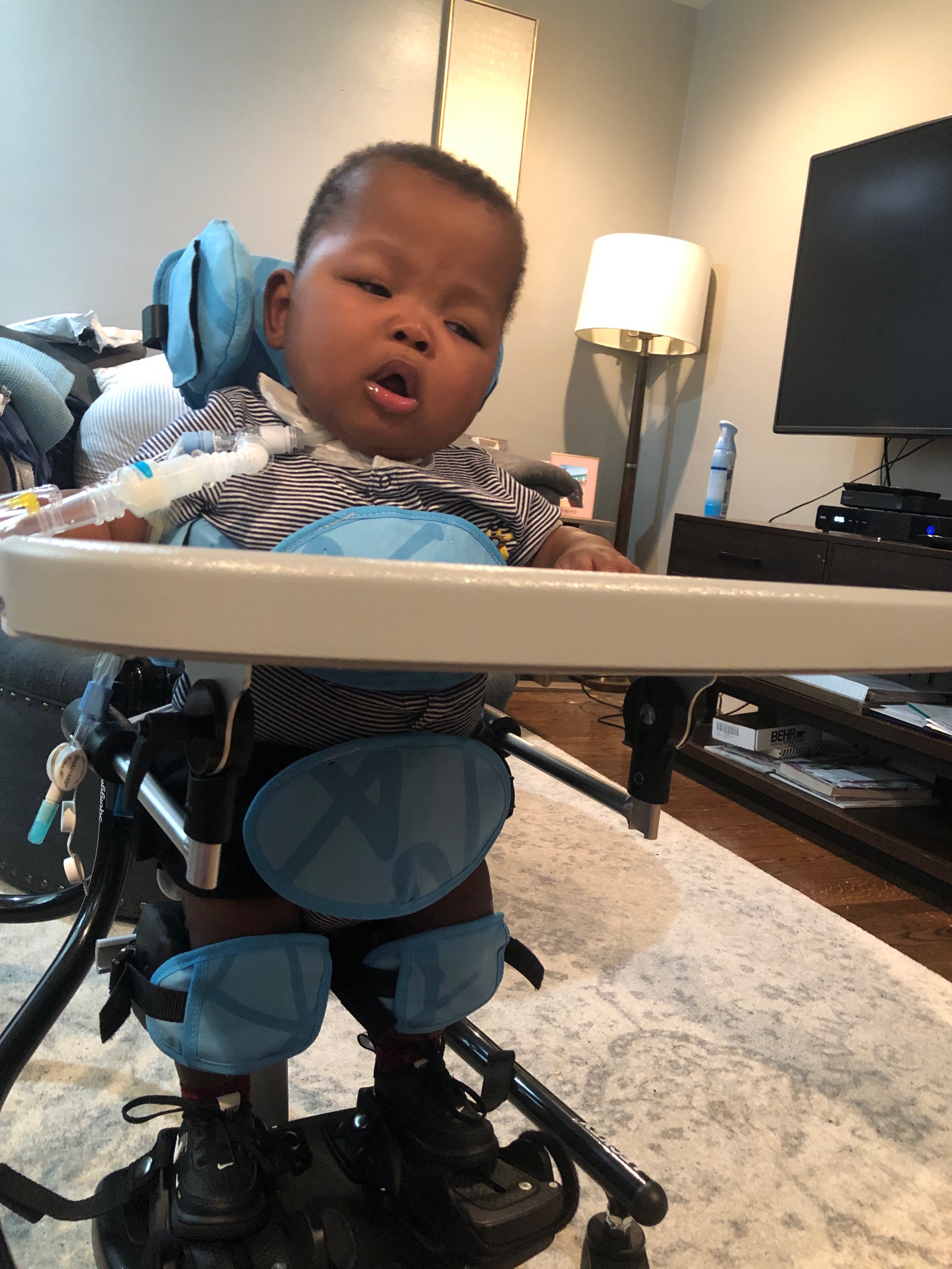 Zy'Aire working in his stander to help him learn to put weight on his legs.