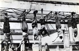 Mussolini and his mistress hanging by their feet having been killed by the mob. Populists should recognise that the mob is fickle.. and unforgiving of falsehoods that bring disaster.... -