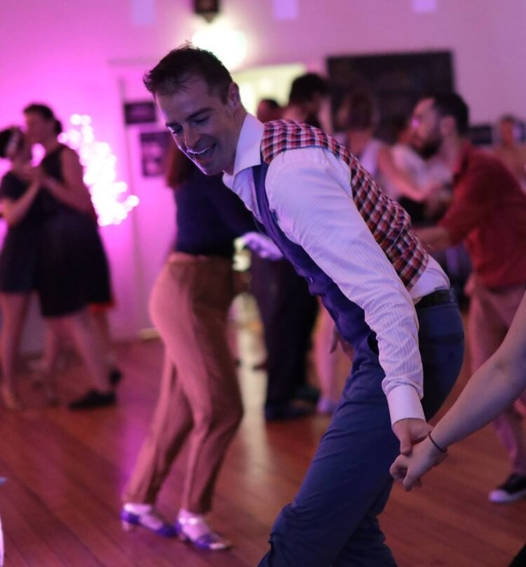 Andy Fodor - After taking up residency in Melbourne Andy started dancing in 2004. Andy loves teaching at North Melbourne every Thursday with his wife Shobhana Nambiar, and loves creating a fun, playful environment for all to explore their dancing. Andy's down-to-earth teaching style tends to relax those around him and his passion for swing dancing ends up rubbing off on his students.He loves dancing with everyone from beginners to teachers, and tries to leave his partner smiling by the end of each song.He's been very privileged to teach with an amazing teacher, dancer and choreographer Shobhana, as well as many other great teachers over the years. Australian Teaching/Workshop credits include: Melbourne, Brisbane, Sydney, Canberra, Adelaide, Perth, Launceston, Hobart, And Andy and Shob have taught in NZ, Spain, New Caledonia and Victoria (Canada) too.Andy has also taught performance troupes in Sydney and Melbourne with the talented trio of Shob Nambiar, Noni Clarke, and Cathie Gough.