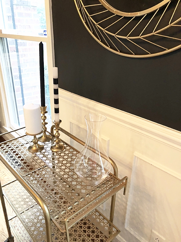 One of my favorite walls in the house thus far. This is in our dining room. Yes, the wall are black!!!
