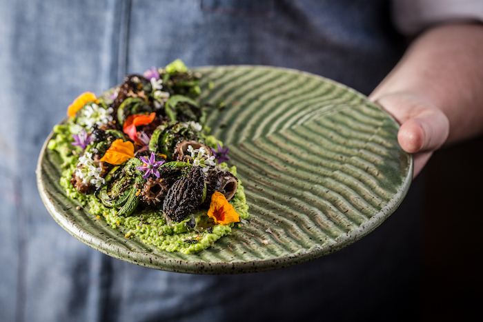 Even a dish as simple as hummus is transformed into a pastoral display with fava beans, fiddleheads and furikake.  Photograph by Galdones Photography