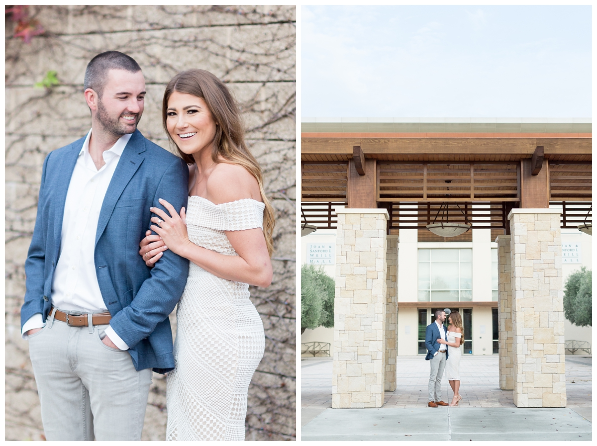engaged bride wears a white dress and her fiancé wears a blue suit for their engagement photo session