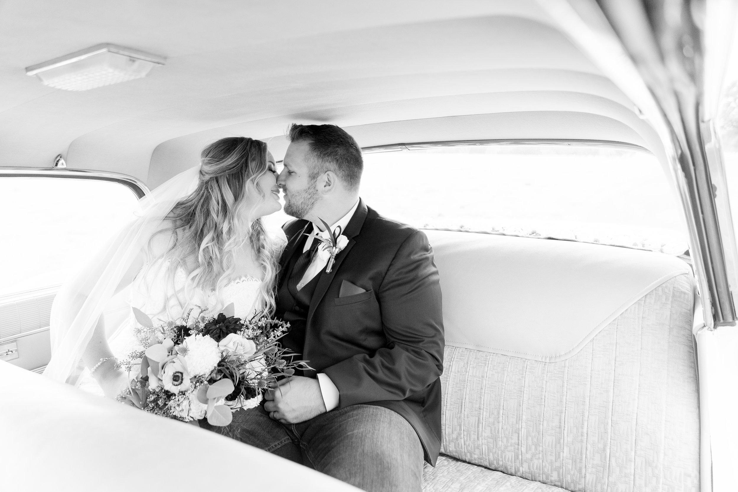 bride-and-groom-sunset-photos-in-vintage-car(184 of 220).jpg